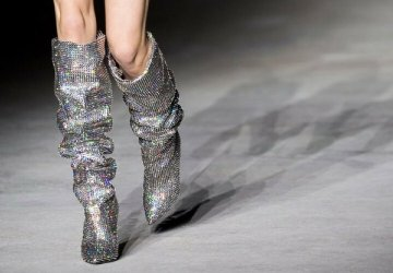 Saint Laurent rhinestone slouch boots on the runway