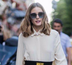 Olivia Palermo wearing chic creme shirt