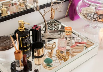 See how to organise your vanity using trinket boxes.