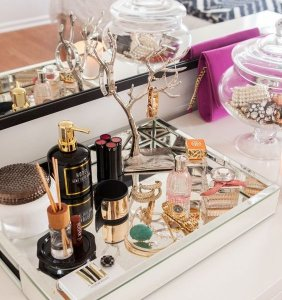 See how to organise your vanity using catchall trays.