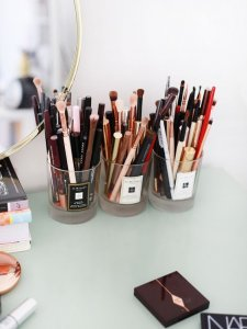 See how to organise your vanity using pretty canisters.