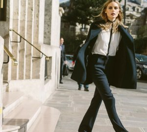 Olivia Palermo is wearing a pair of flared jeans, which are the trend for spring.