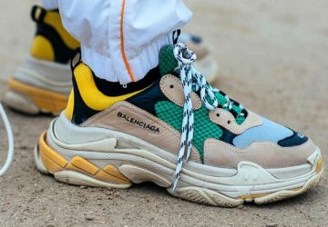 Dad sneakers are taking over street style this season, whether we like it or not. Here are some of the reasons why everyone wears them.