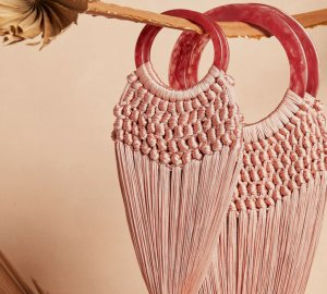 The bag of the season is made of bamboo and fishnet and of course comes by Cult Gaia.