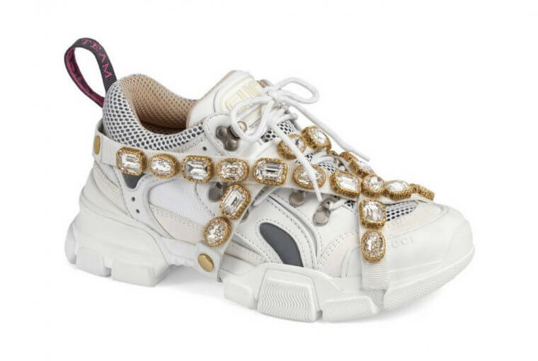 Do you feel like spending your monthly rent on a pair of shoes? If yes, Gucci has the shoes for you coming as pair of bejewelled sneakers.