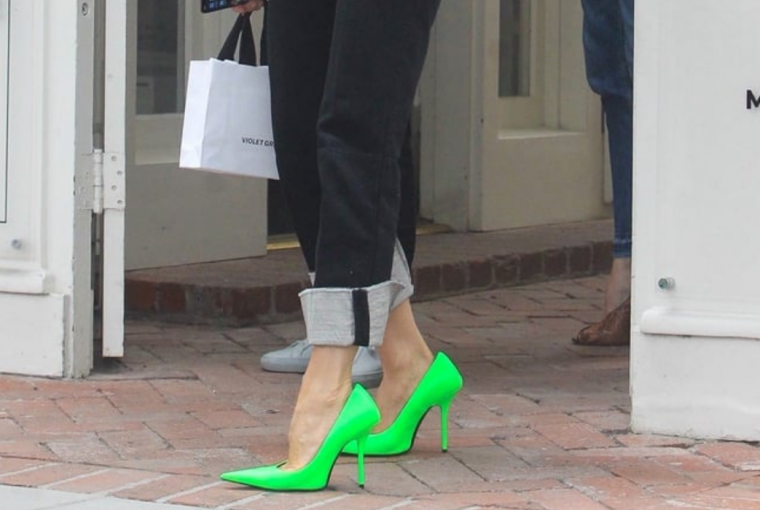 Victoria Beckham opted for neon lime green Balenciaga shoes which definitely make her stand out during a shopping trip last week.