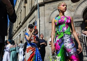Fashion week magic also occurs in the streets where fashion art merges with the vibrant city and makes it even more exciting.