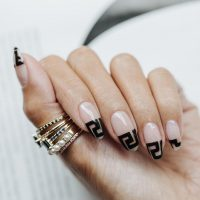 On the verge of kitsch or proof of exquisite taste a nail art with a luxury brand logo is the latest trend in nails. Love it hate it, they're here and we offer few ideas.